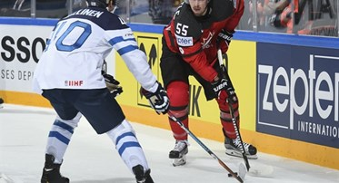 PARIS, FRANCE - MAY 16: Canada's Mark Scheifele #55 stickhandles the puck while Finland's Tomi Sallinen #40 defends during preliminary round action at the 2017 IIHF Ice Hockey World Championship. (Photo by Matt Zambonin/HHOF-IIHF Images)