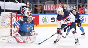 COLOGNE, GERMANY - MAY 18: USA's J.T. Compher #7 with a scoring chance against Finland's Harri Sateri #29 while Atte Ohtamaa #55 looks on during quarterfinal round action at the 2017 IIHF Ice Hockey World Championship. (Photo by Andre Ringuette/HHOF-IIHF Images)